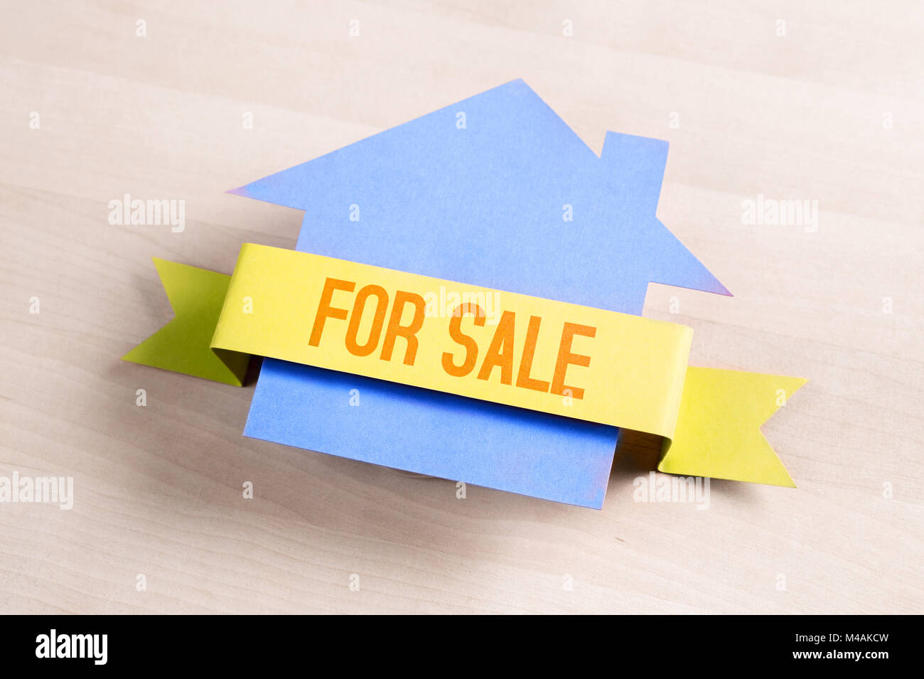 House for sale. Real estate business concept. Selling and buying home. Cottage made from cardboard paper on wooden - Stock Image