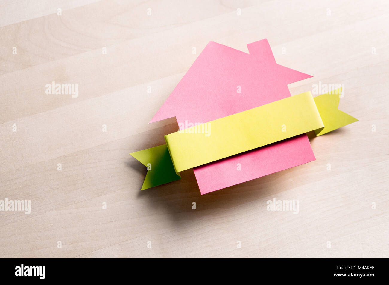 house for sale cottage made from cardboard paper on wooden table house warming party template empty blank ribbon with negative copy space