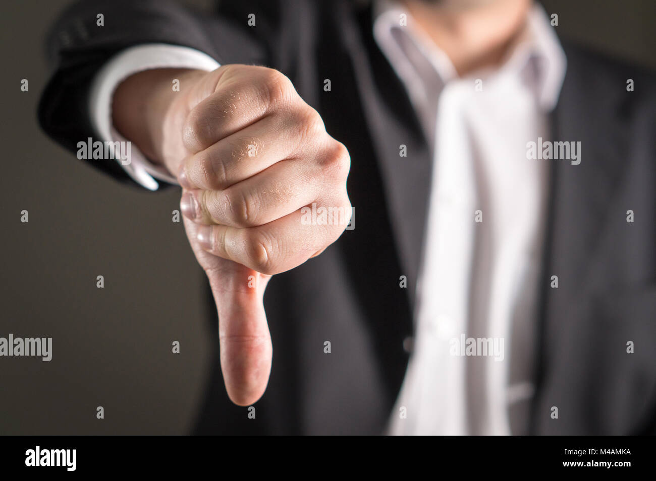 Business man showing thumbs down. - Stock Image