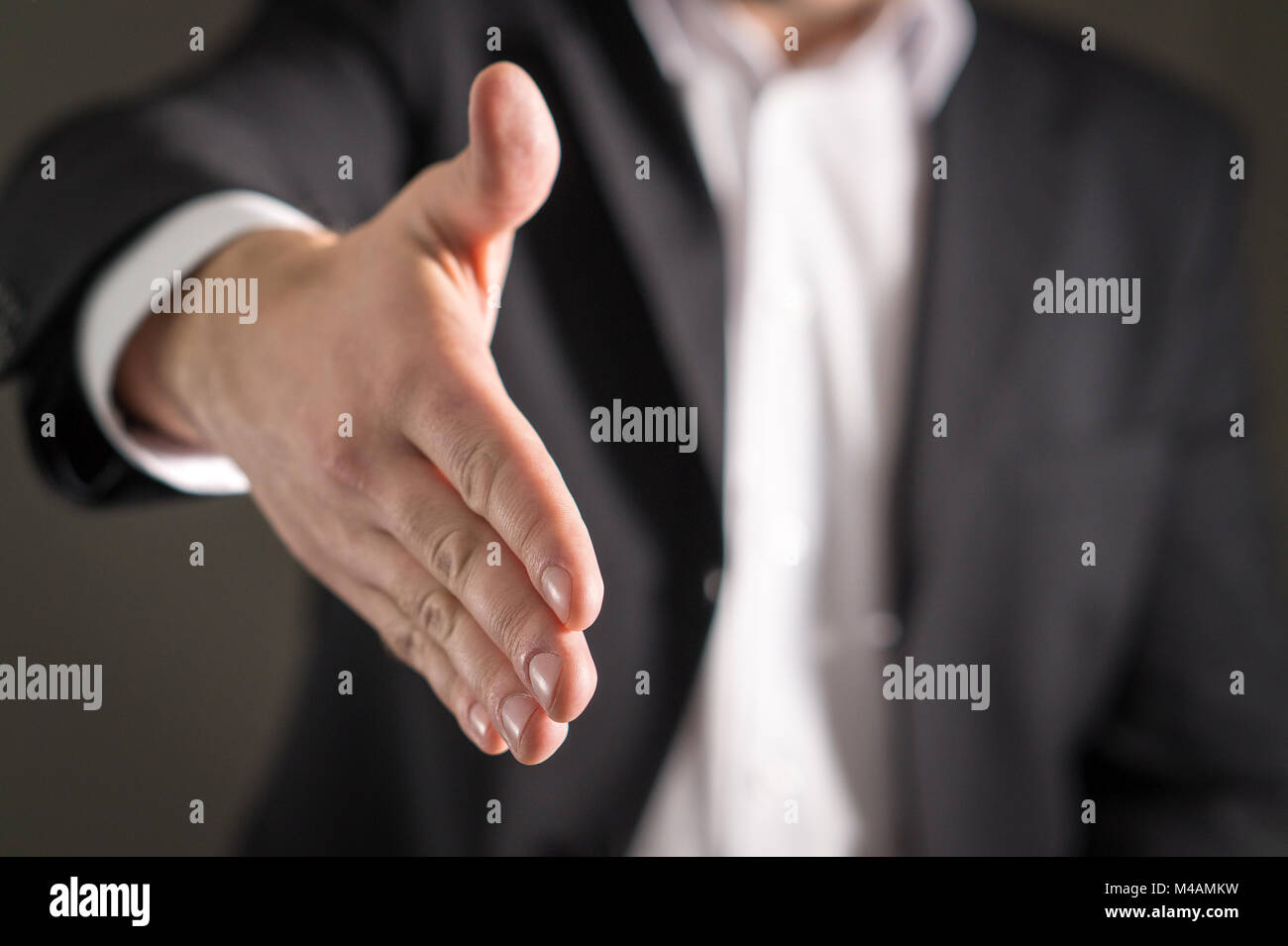 Business man offer and give hand for handshake. Salesman or real estate agent shake for deal, agreement or sale. - Stock Image