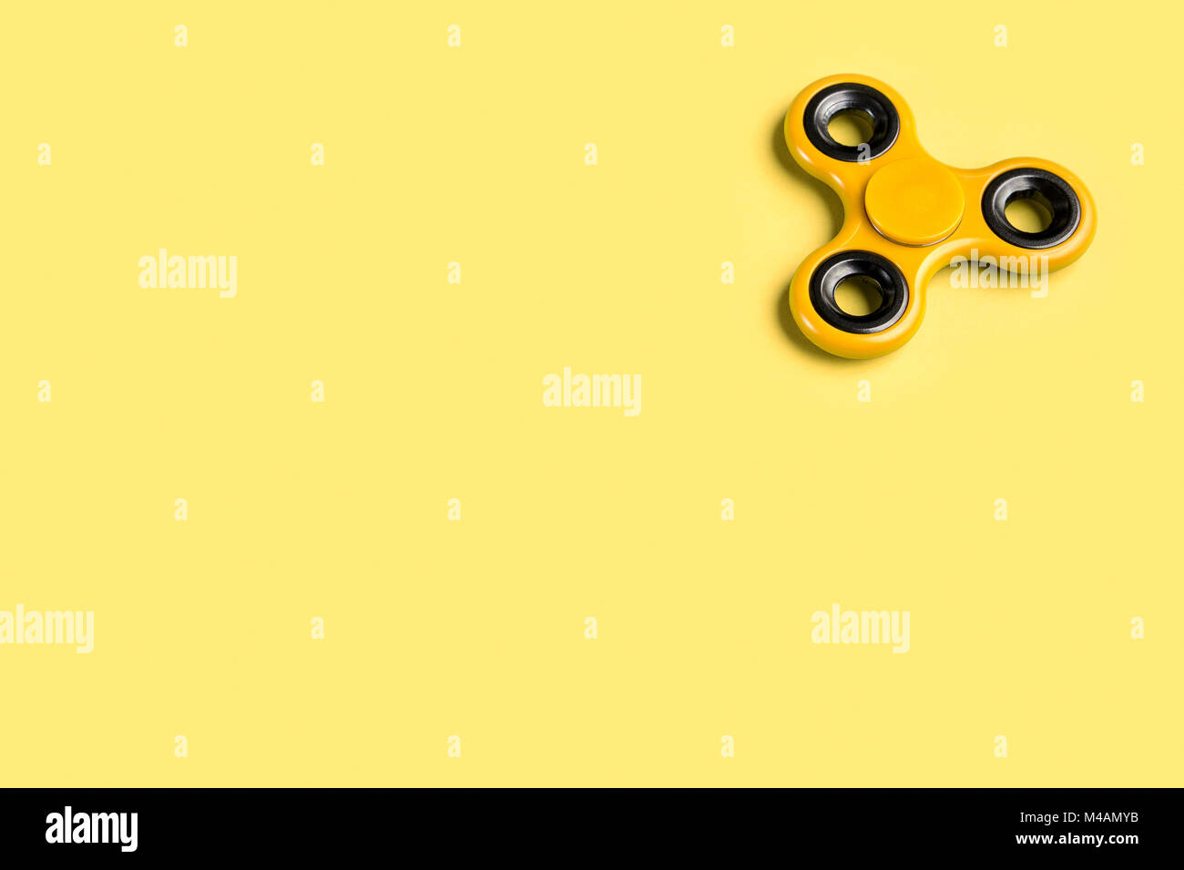 yellow fidget spinner background template with copy space popular