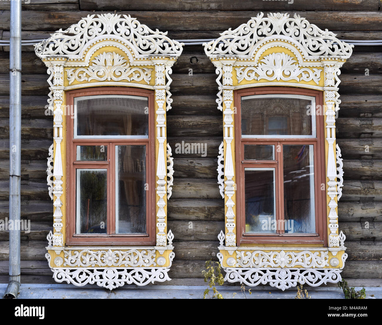 Wooden decorating of windows old residential buildings - Stock Image
