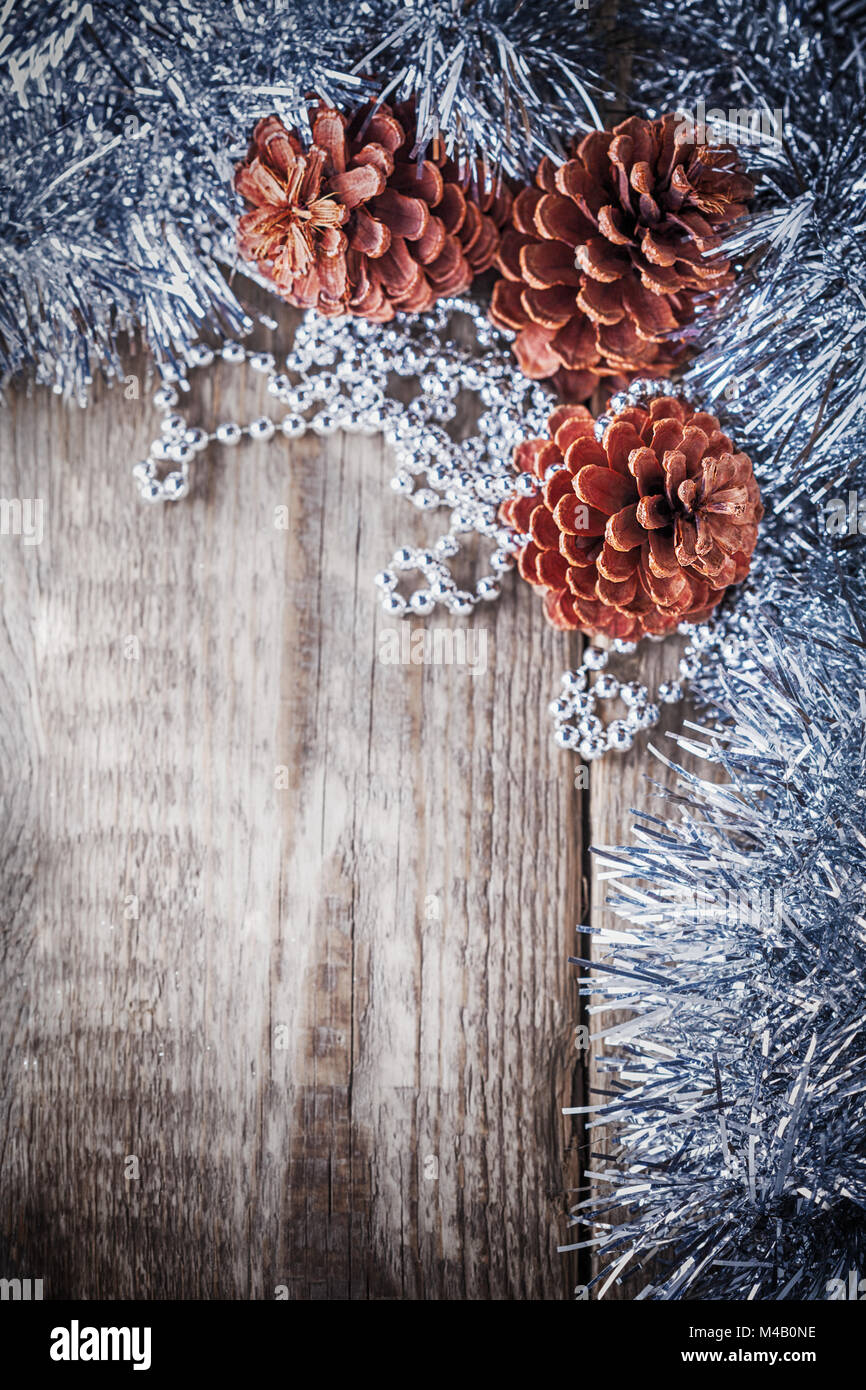 Home decor pine cones on a wooden background - Stock Image