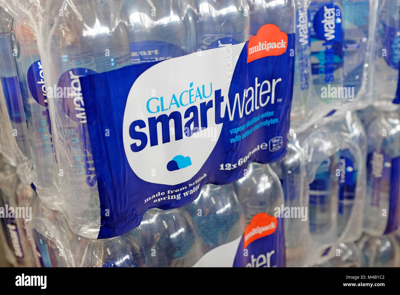 smart water in plastic bottles in supermarket - Stock Image