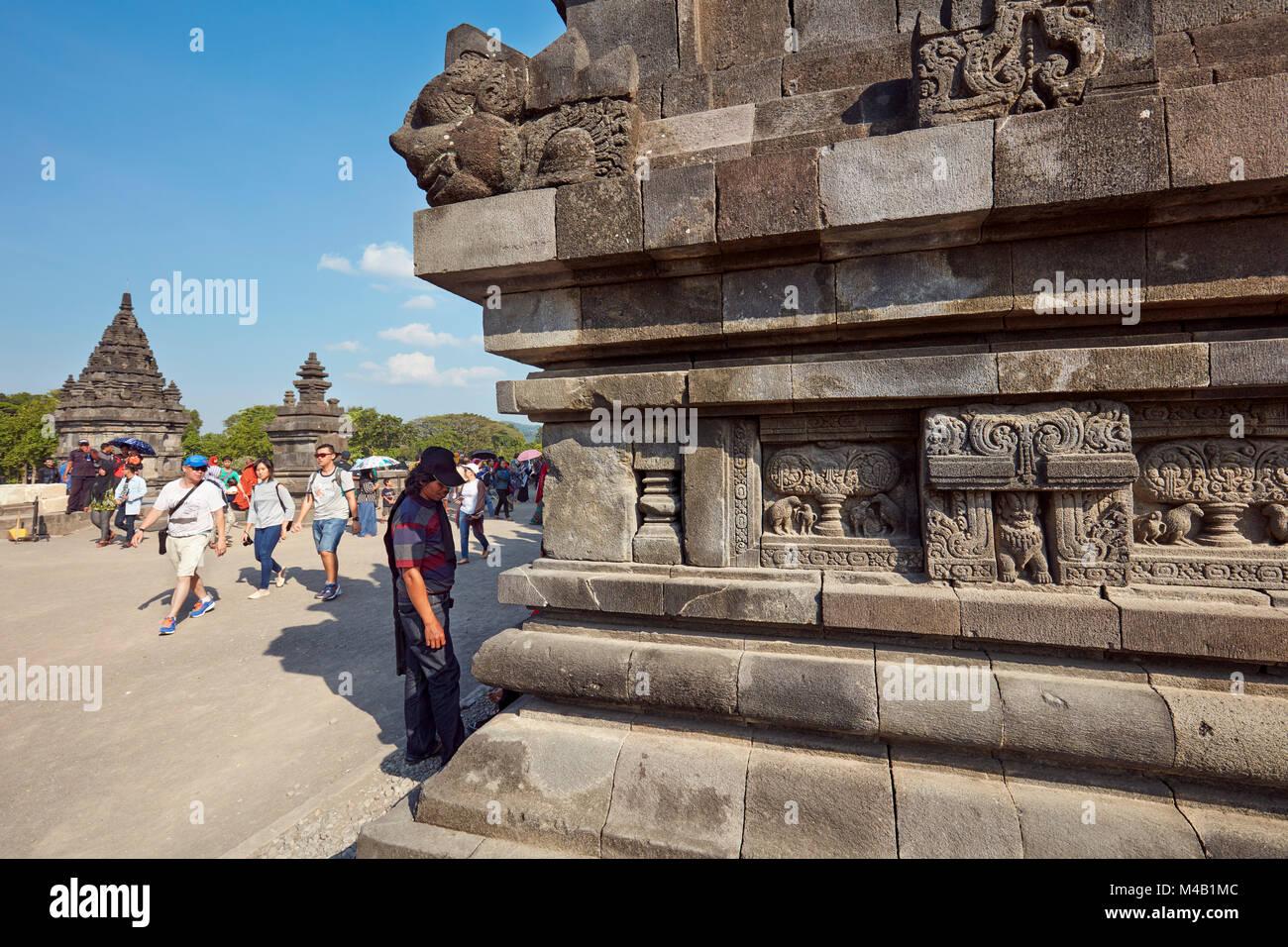 Stone carvings on a tower base. Prambanan Hindu Temple Compound, Special Region of Yogyakarta, Java, Indonesia. - Stock Image