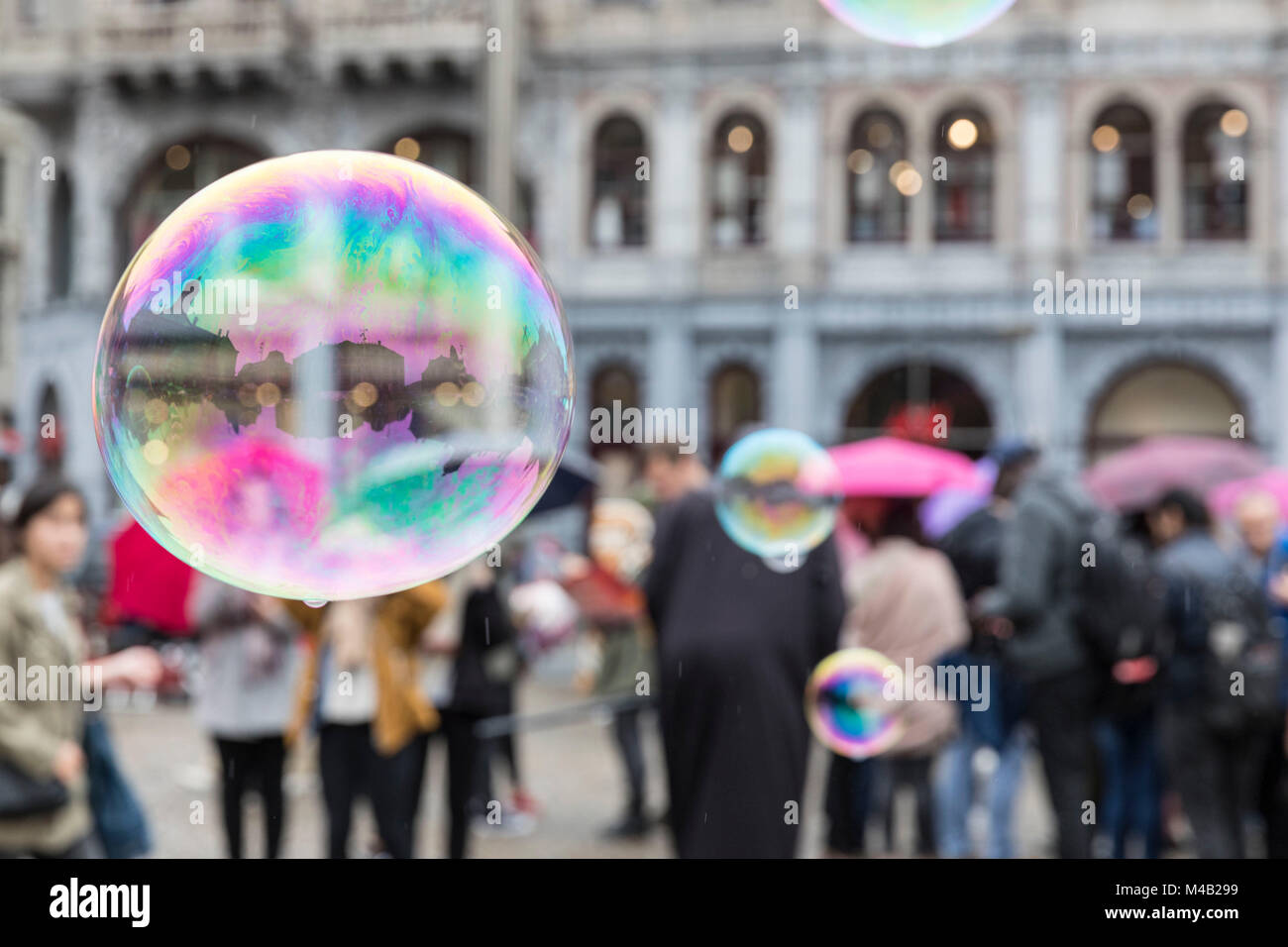The Netherlands,Holland,Amsterdam,Dam,bursting bubble with reflexion - Stock Image