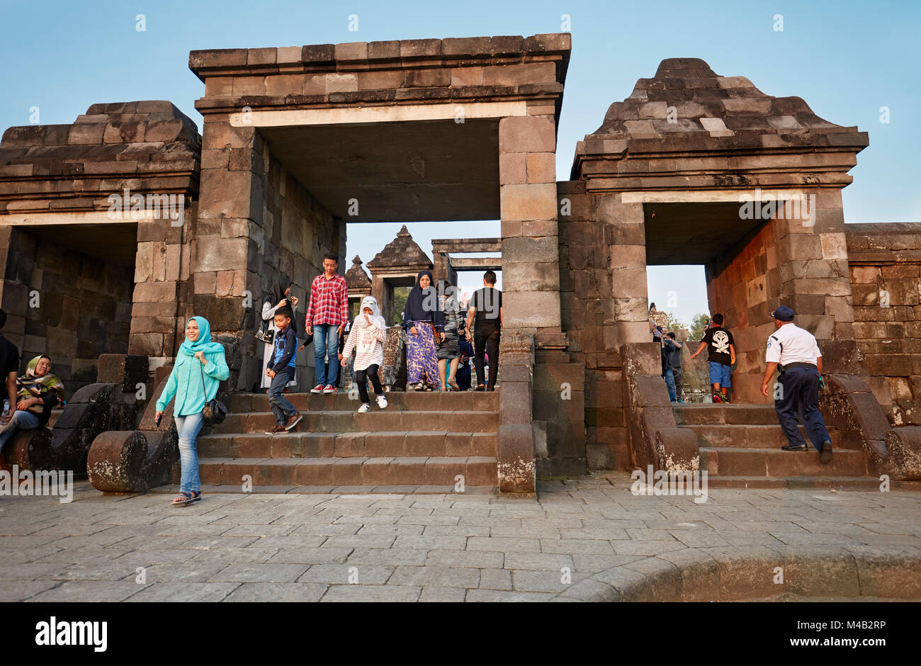 Visitors at the main gate of Ratu Boko Palace compound. Special Region of Yogyakarta, Java, Indonesia. - Stock Image