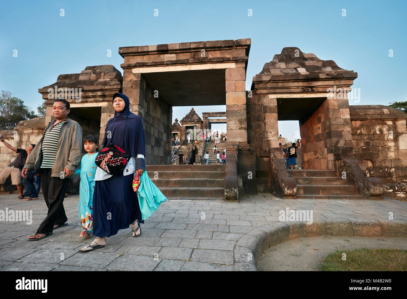 Muslim family visiting the Ratu Boko Palace compound. Special Region of Yogyakarta, Java, Indonesia. - Stock Image