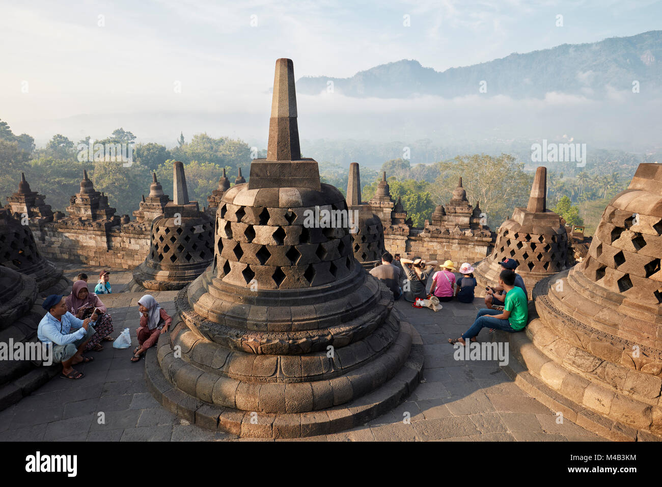 Tourists in Borobudur Buddhist Temple. Magelang Regency, Java, Indonesia. - Stock Image