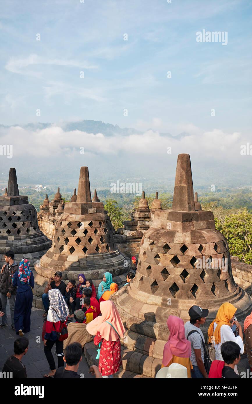 Tourists in Borobudur Buddhist Temple. Magelang Regency, Java, Indonesia. Stock Photo
