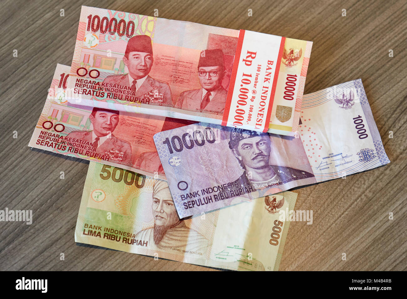 Indonesian paper money with different face values laying on a table. Yogyakarta, Java, Indonesia. - Stock Image