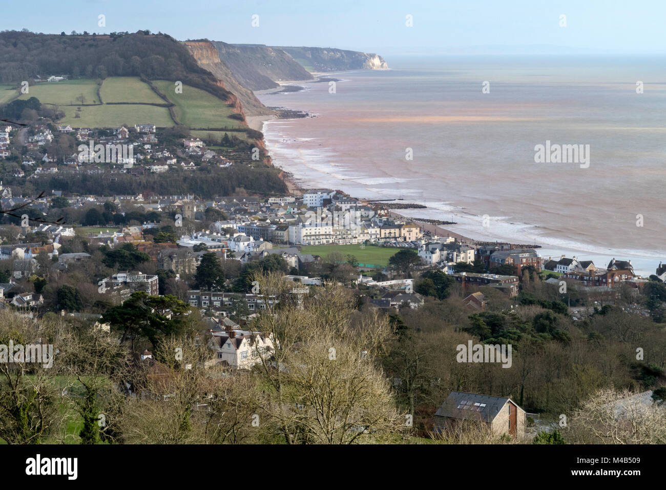 Walkers view down onto Sidmouth from the footpaths in Mutters Moor, alongside Peak Hill, Sidmouth, Devon, UK - Stock Image