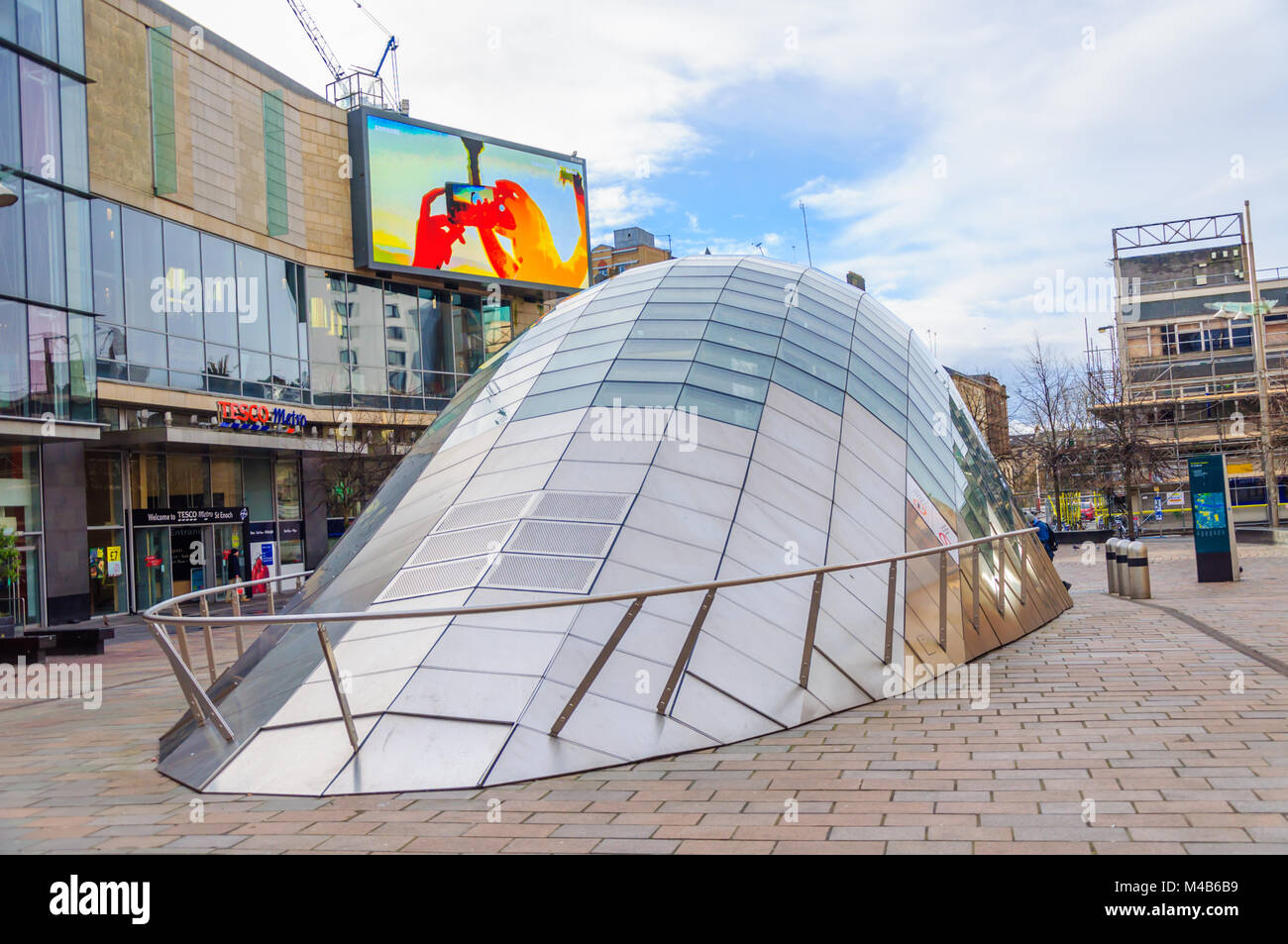 Modern design of the glass and steel canopy at the entrance of St. Enoch subway station at St Enoch Square, Glasgow, - Stock Image