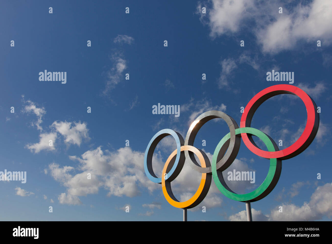 LONDON, UK - February 15th 2018: The Olympic symbol, made up of five interconnected coloured rings, under a blue - Stock Image