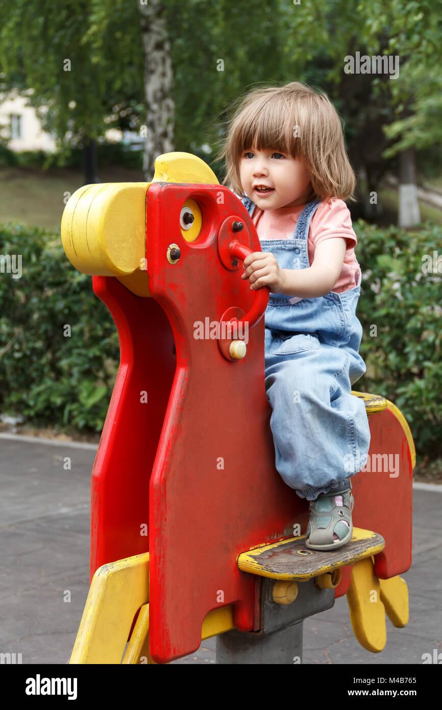 Baby girl loud screaming on playground - Stock Image