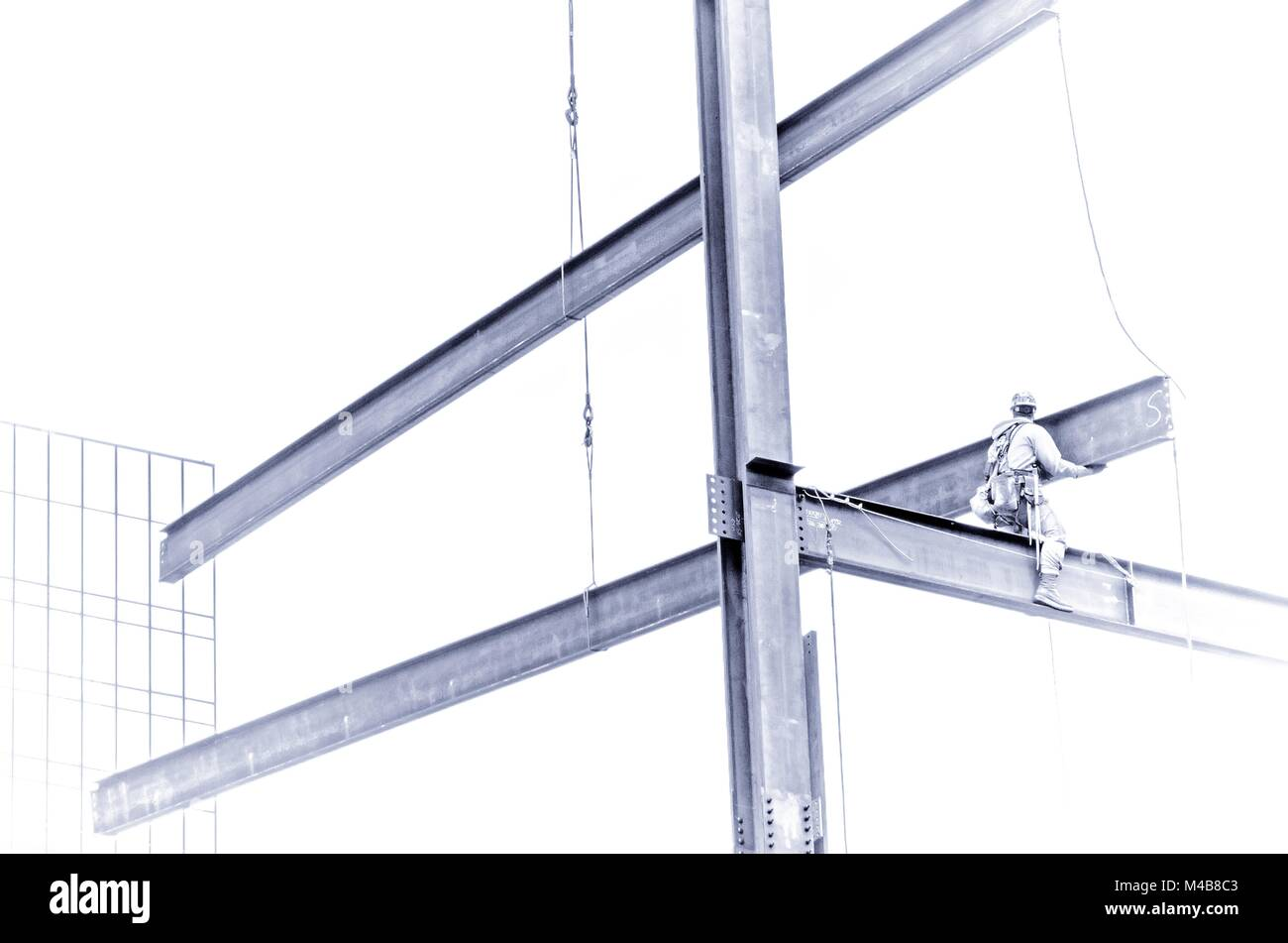 construction worker working on highrise building - Stock Image