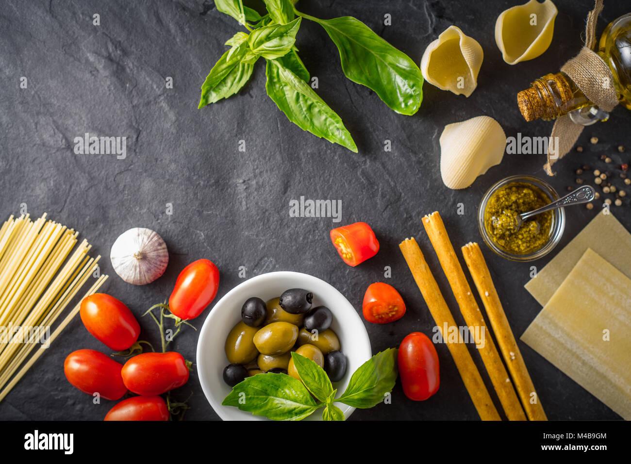 Italian food still life on the dark table top view - Stock Image