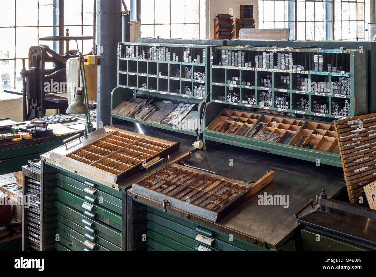 Type case in composing room at printing business, technology for mechanical typesetting text in letterpress printing - Stock Image