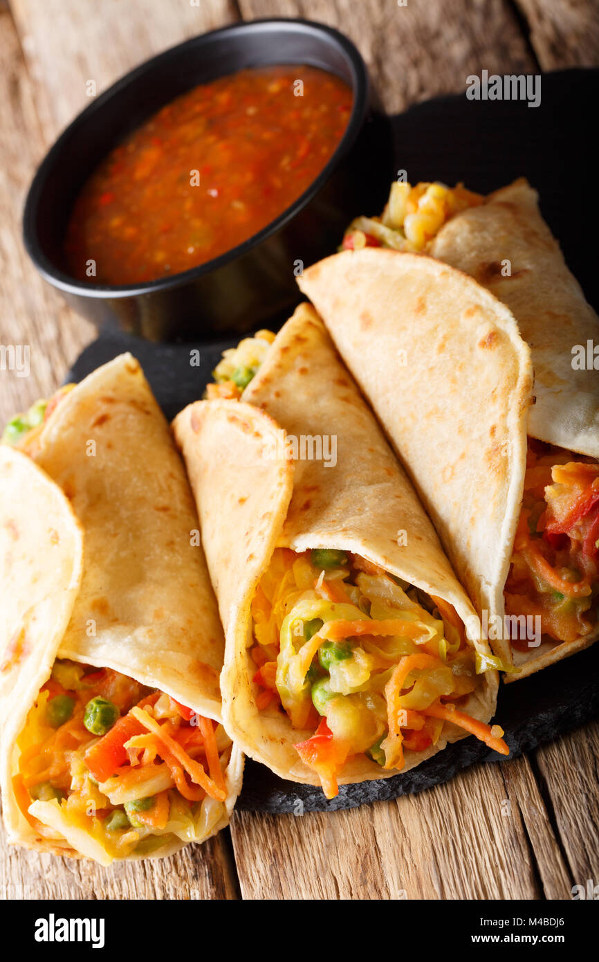 Frankies are also known as Kathi Rolls popular Mumbai street food close-up on the table. Vertical - Stock Image