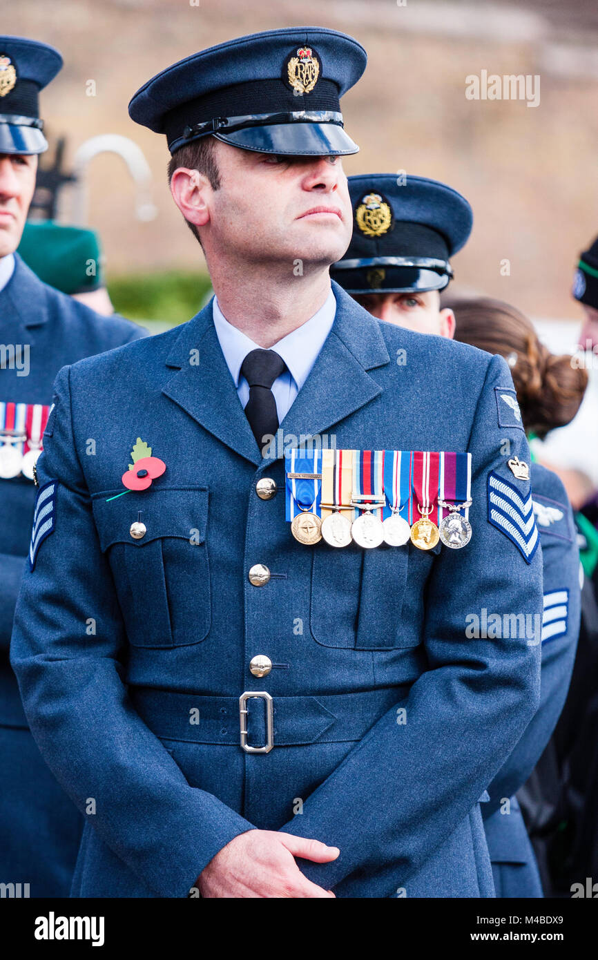England, Ramsgate. Remembrance Sunday. RAF midadult man in blue uniform standing at ease with medals and poppy on Stock Photo