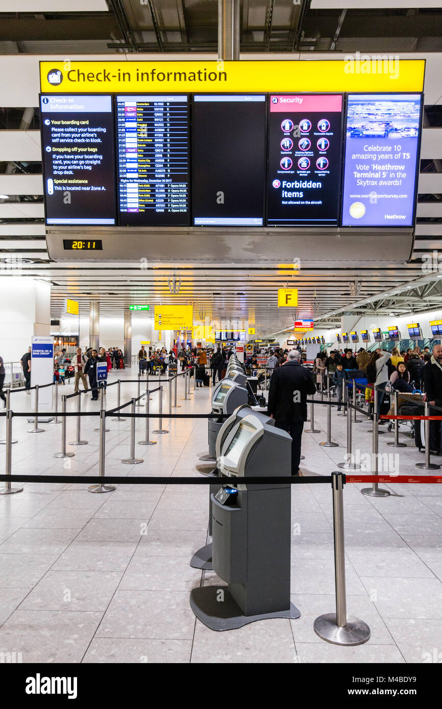 England Heathrow Terminal Four People Queuing At The International