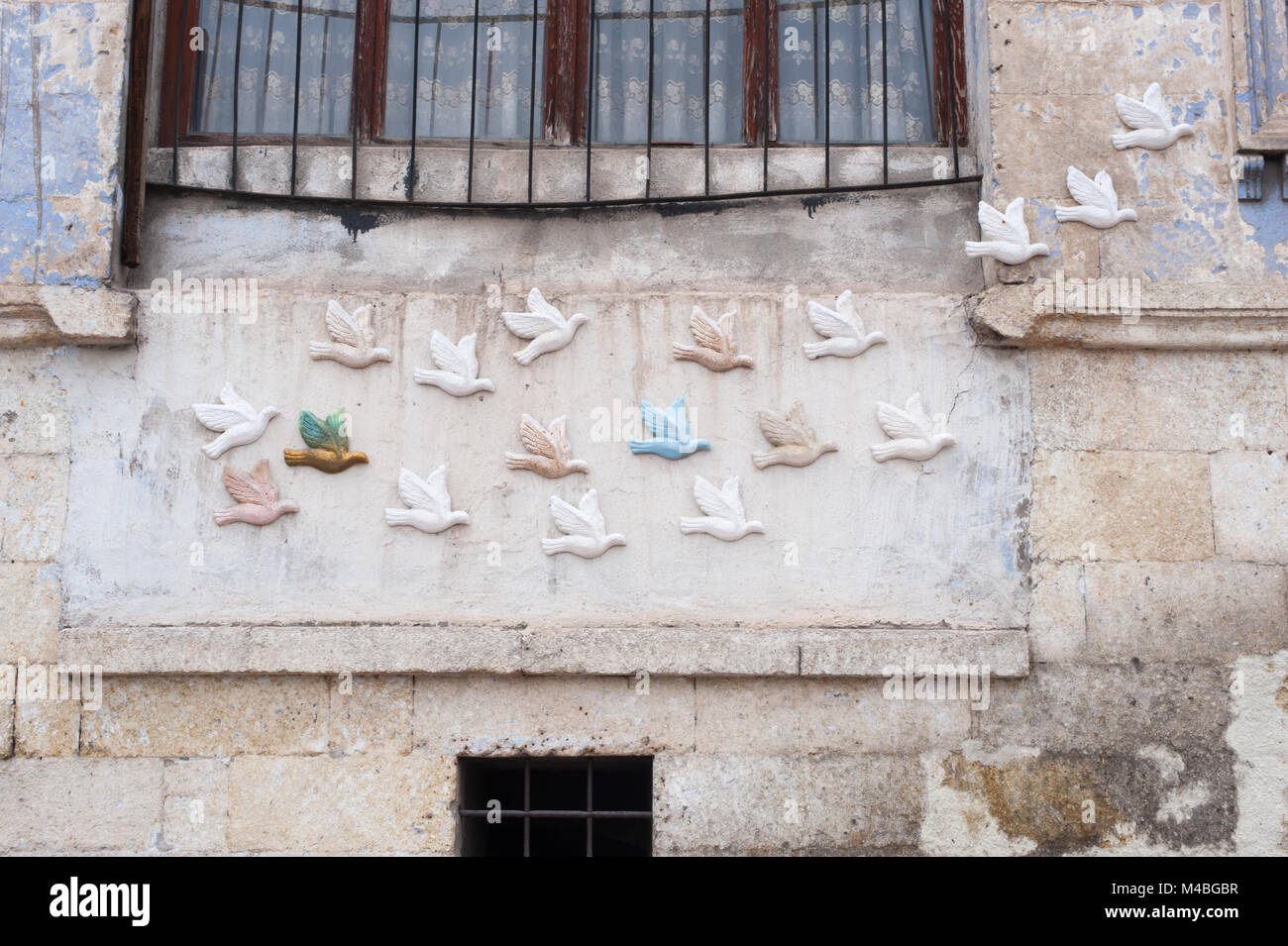 Birds decorate the outside of a building in Turkey. - Stock Image