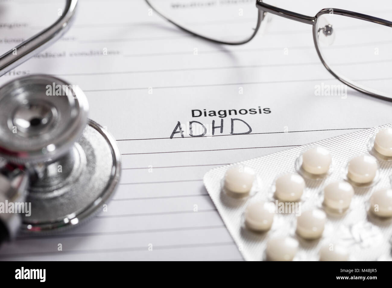Pills;Glasses And Stethoscope With Text Diagnosis ADHD On Paper - Stock Image