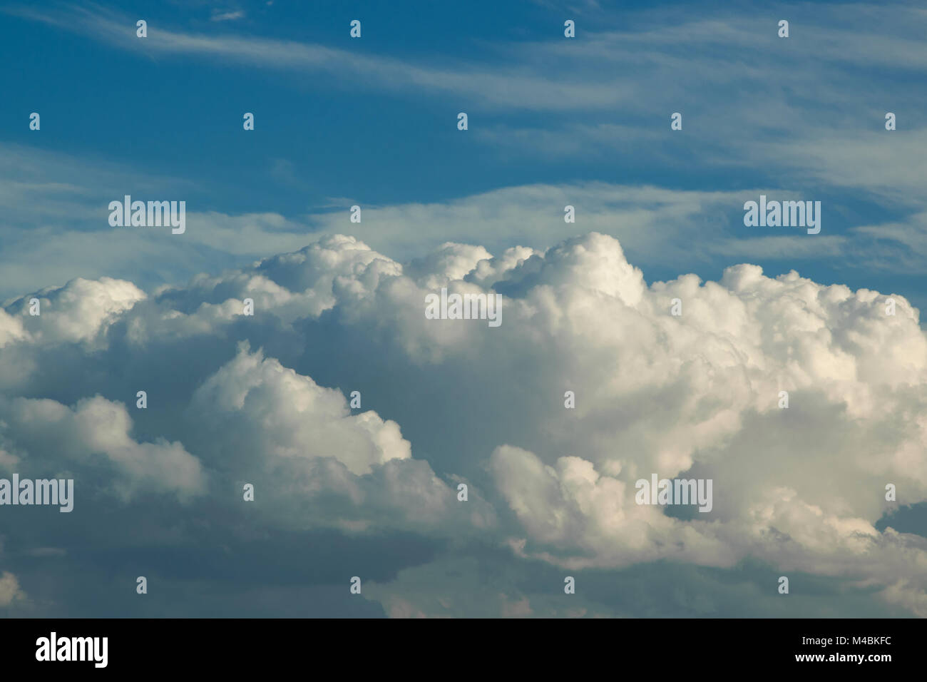 Natural background of fluffy clouds in the sky, space for text - Stock Image