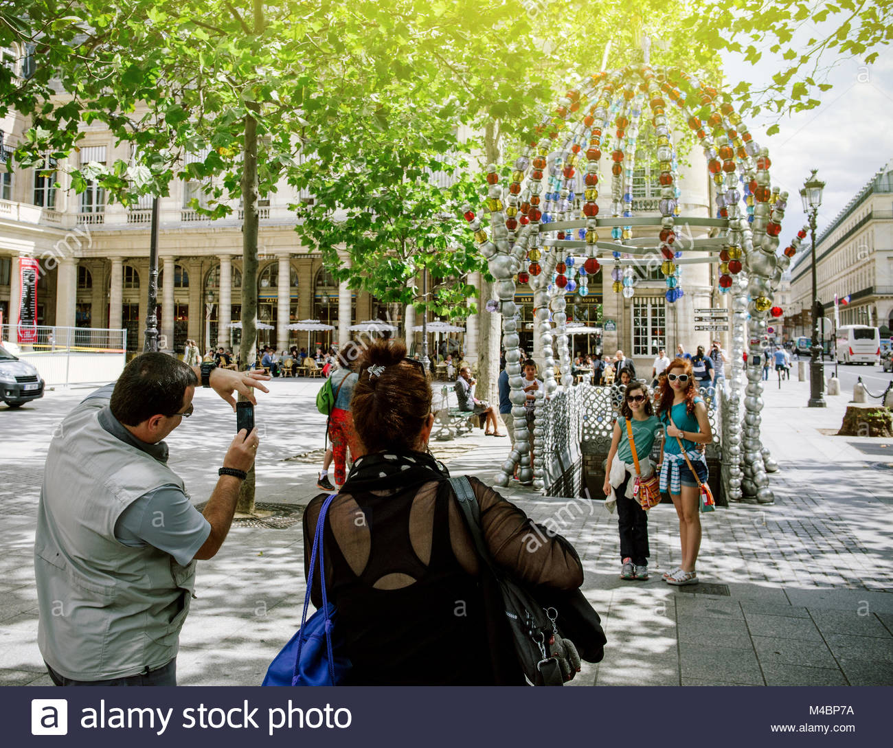 Family visiting Paris and taking photos sunny day Stock Photo