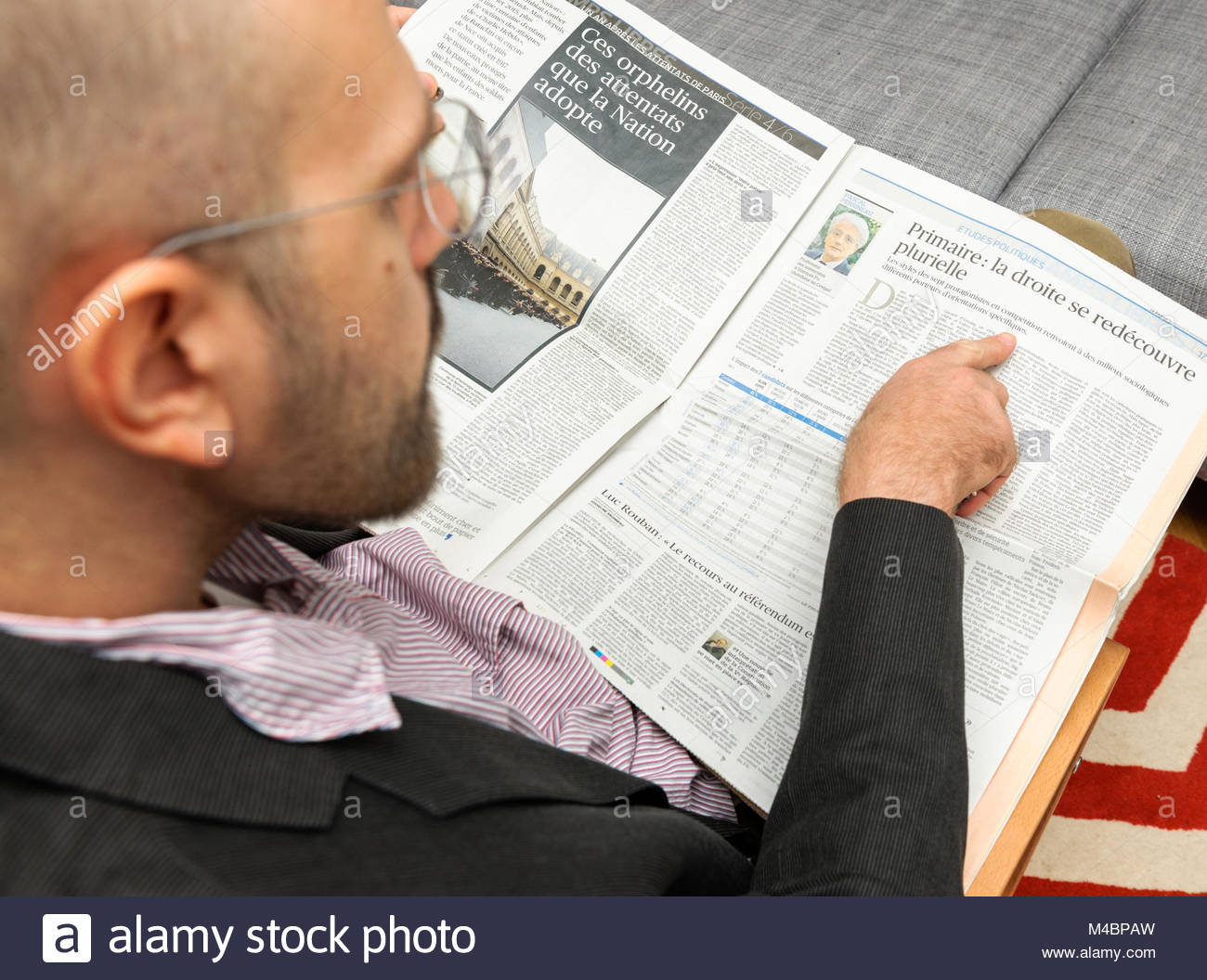 Man reading The Republicans (France) presidential primary - Stock Image