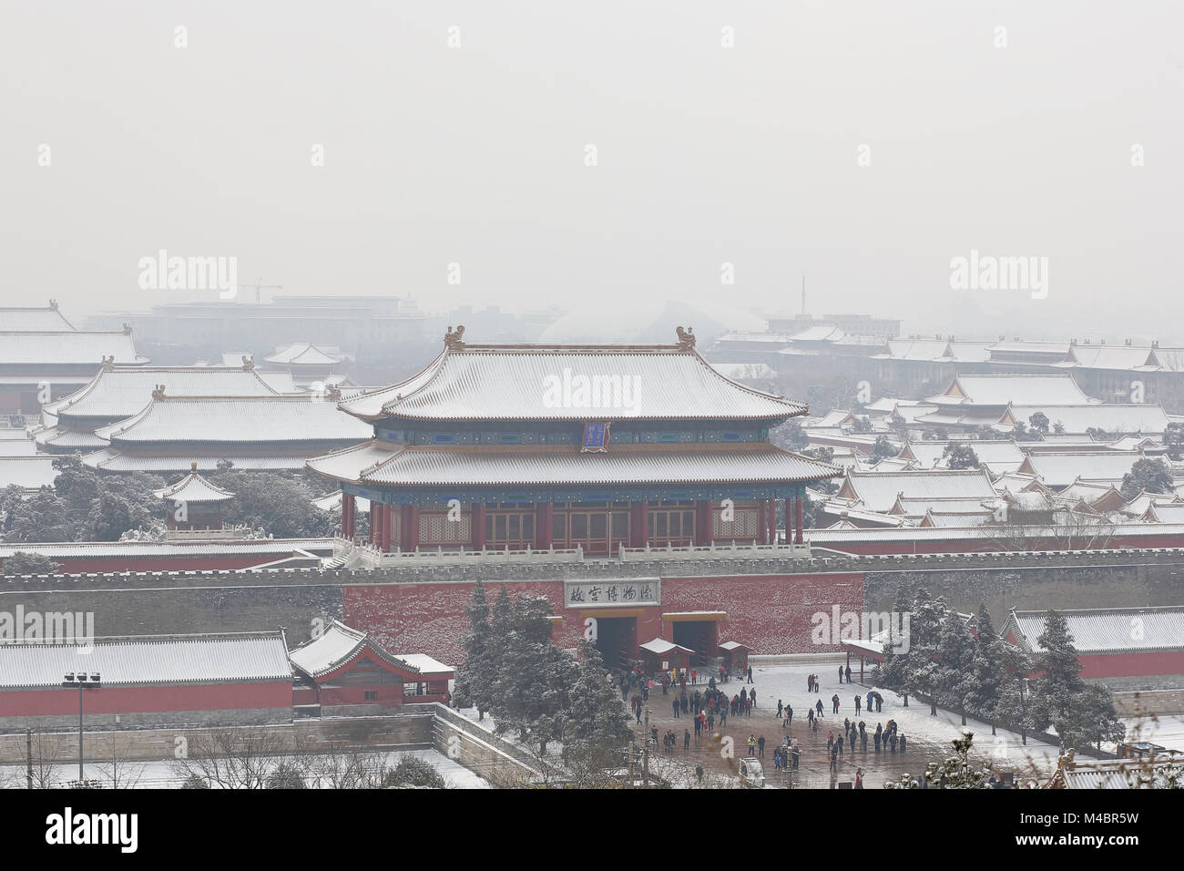 The north gate of the forbidden City in Beijing covered by snow and smog due to a mix of natural fog and pollution.Seen - Stock Image
