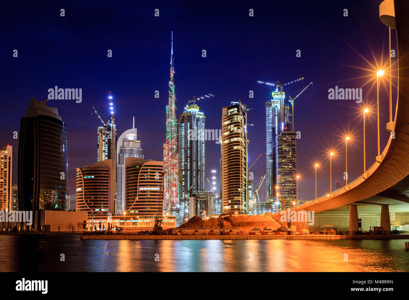 View of Dubai downtown skyline at night - Stock Image