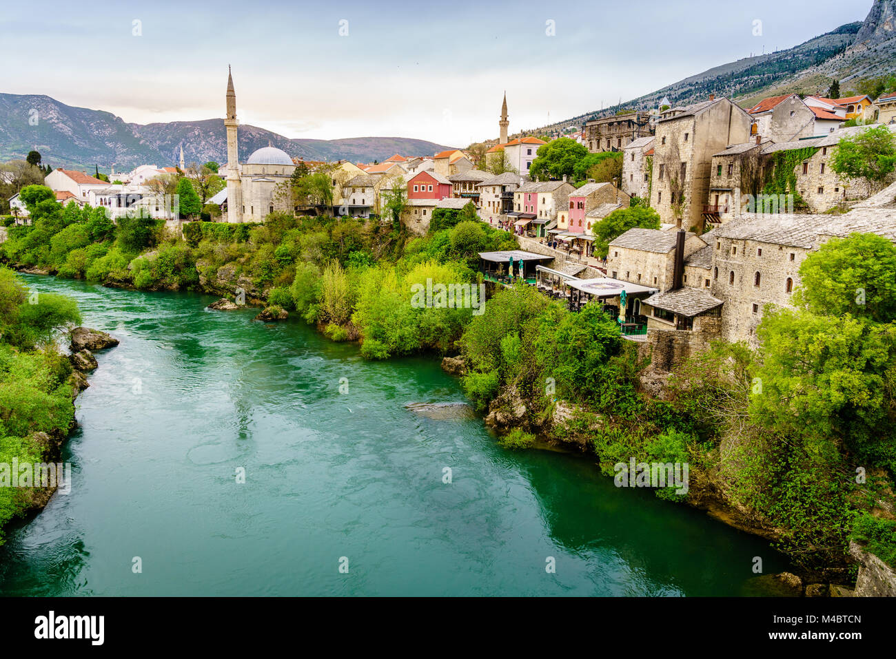Scenic view of the city of Mostar from the bidge across the Neretva River, Bosnia - Stock Image