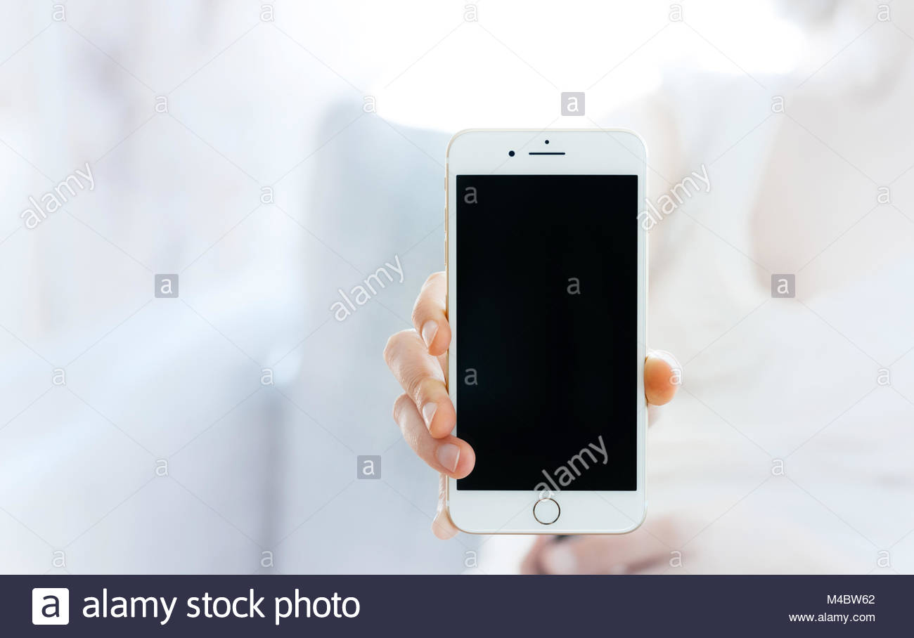 Woman showing the new iPhone 7 plus smartphone. Stock Photo