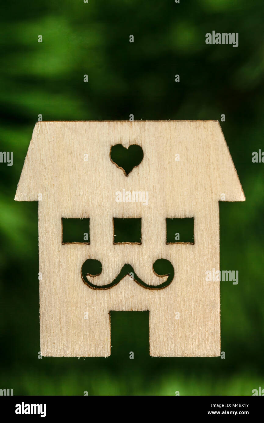 Wooden house facade on abstracted green background - Stock Image