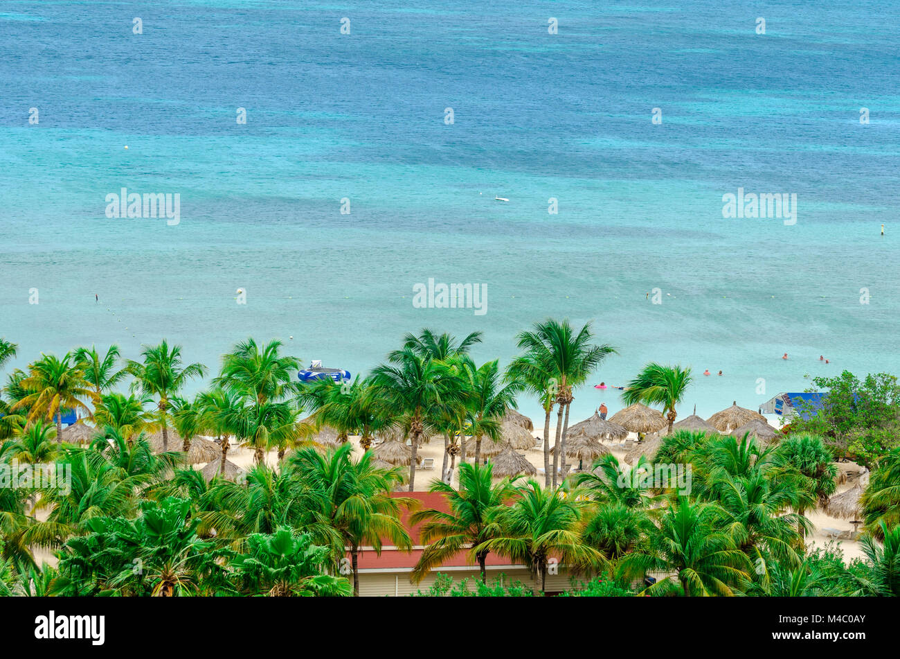 Tourists enjoying the beatiful blue caribbean sea - Stock Image