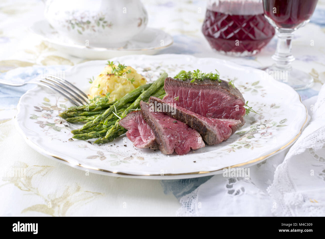 Point Steak with Green Asparagus and Mashed Potatoes - Stock Image