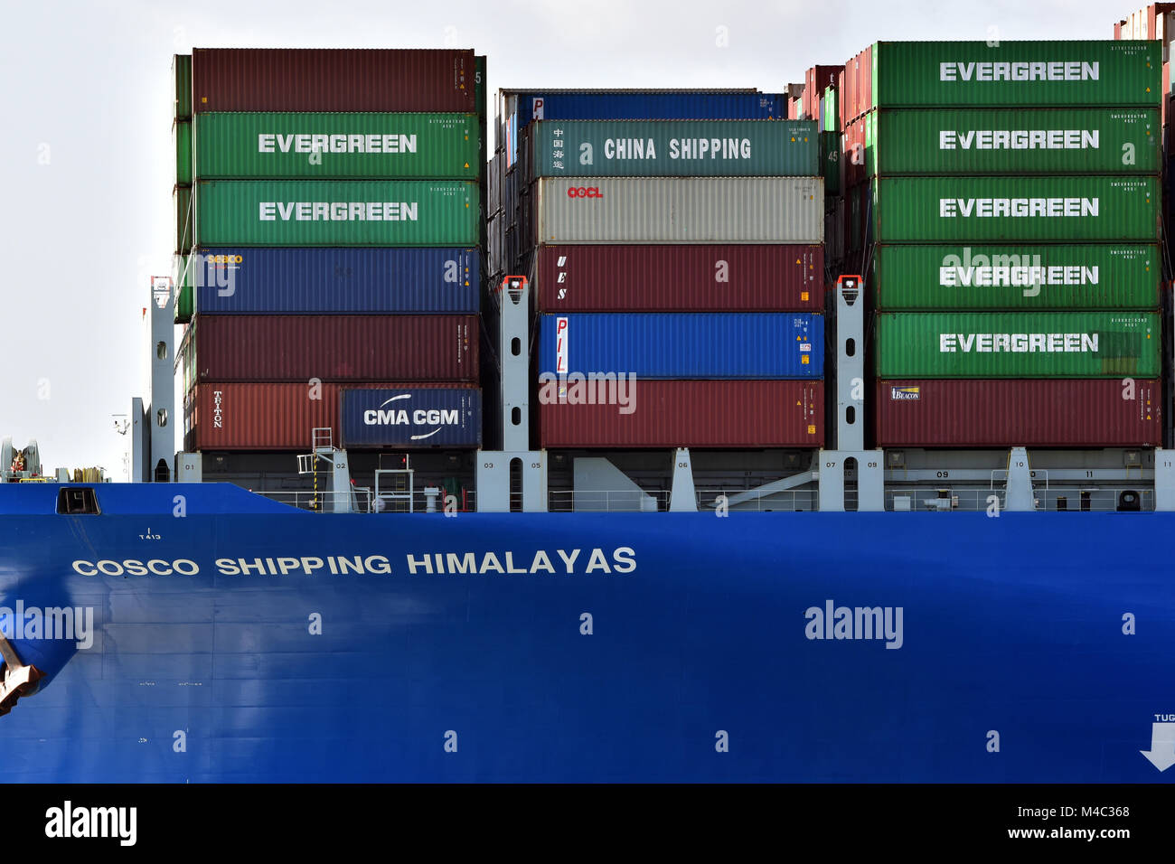 cosco shipping himalayas massive container ship in the port of southampton docks. containerisation import and export - Stock Image