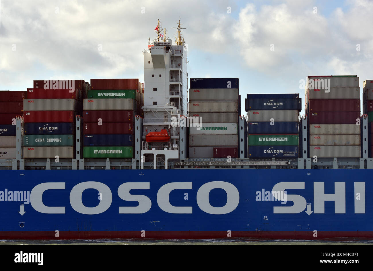 a massive or huge container ship entering or leaving the port of southampton docks. the bridge and deck of a massive - Stock Image