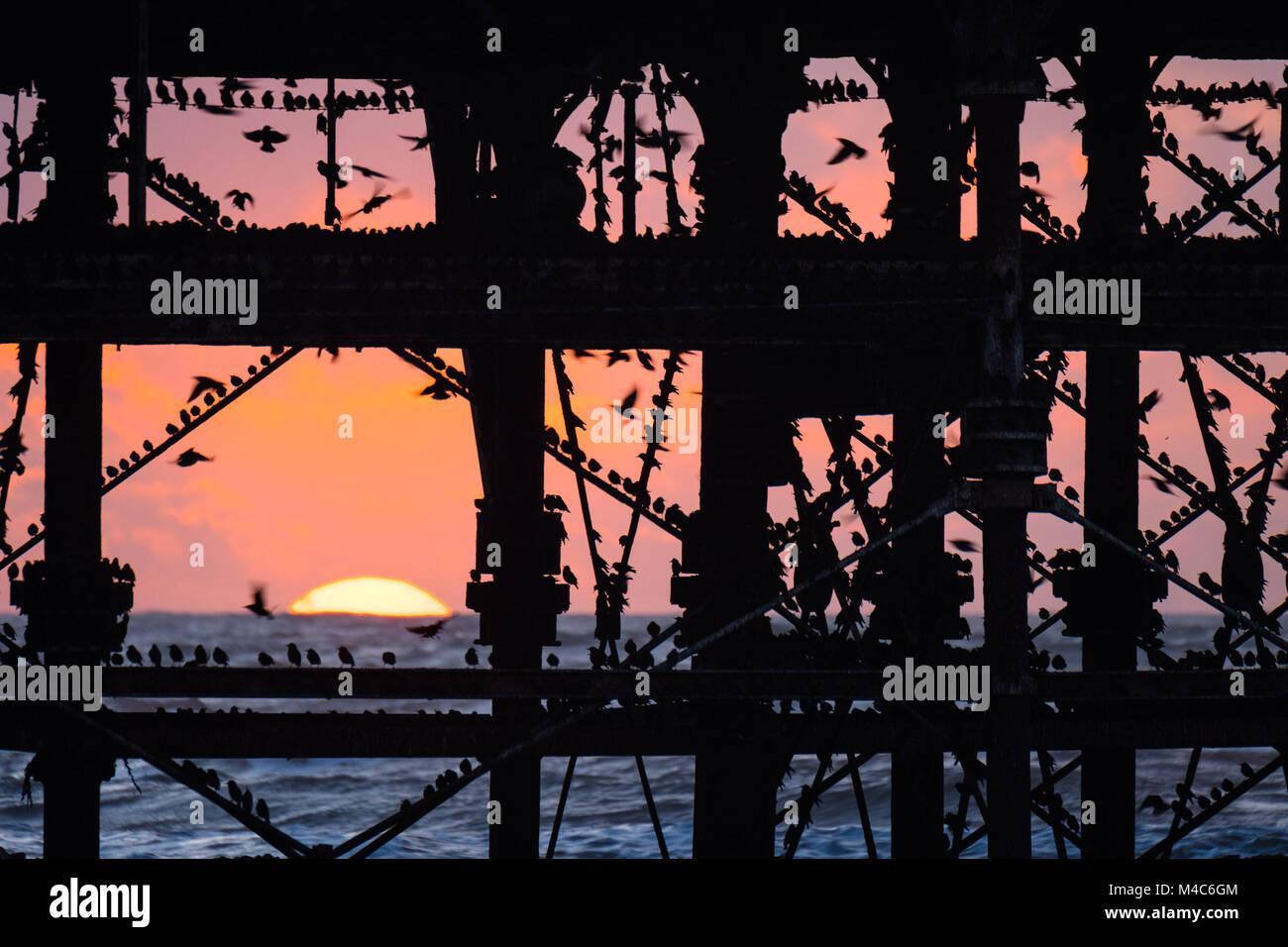 Aberystwyth Wales UK, Thursday 15 Feb 2018  UK Weather:  The setting sun, framed  dramatically behind Aberystwyth Stock Photo