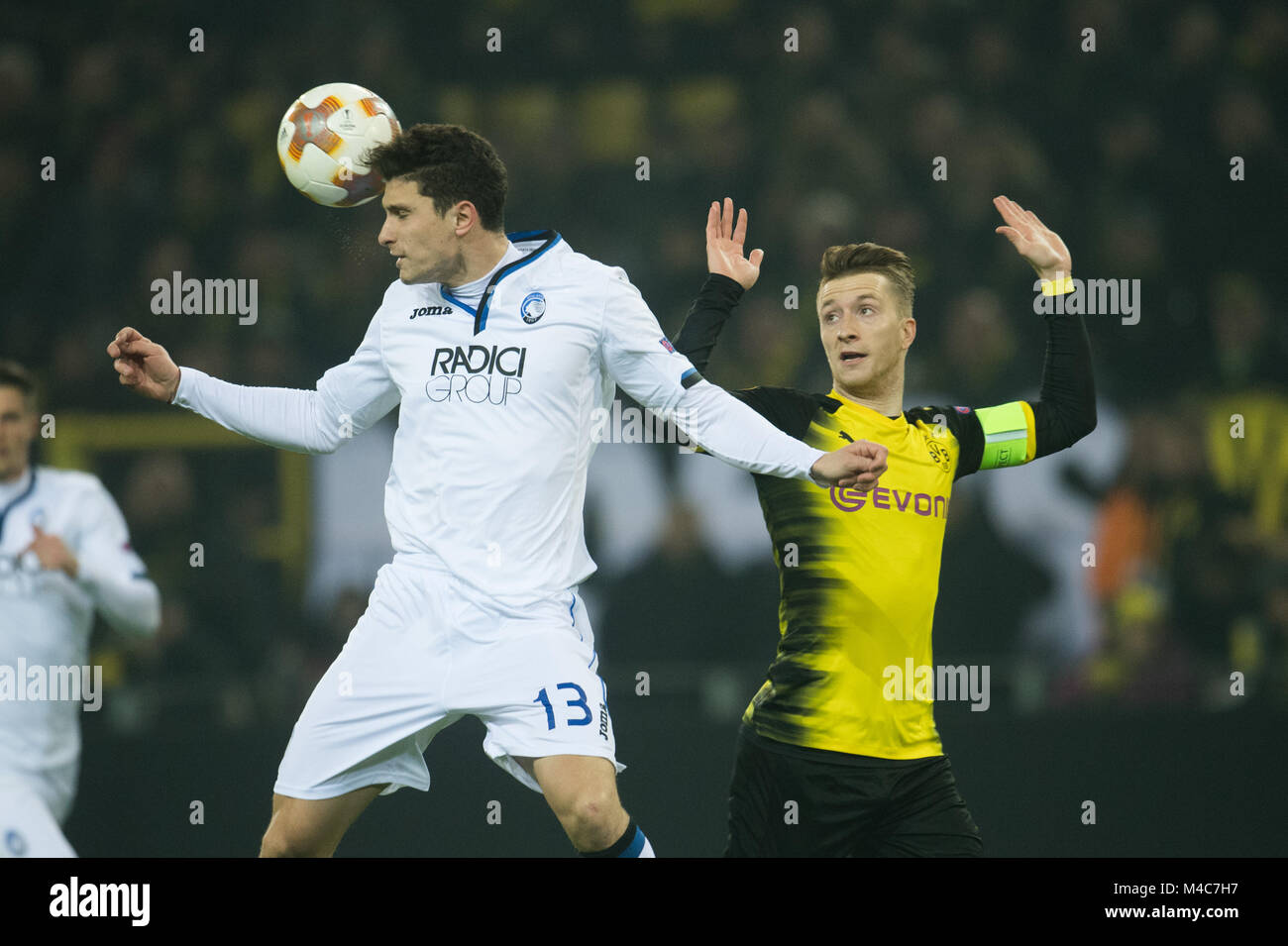 Dortmund, Germany. 15th Feb, 2018. Dortmund's Marco Reus (R) and Bergamo's Mattia Caldara vie for the ball - Stock Image