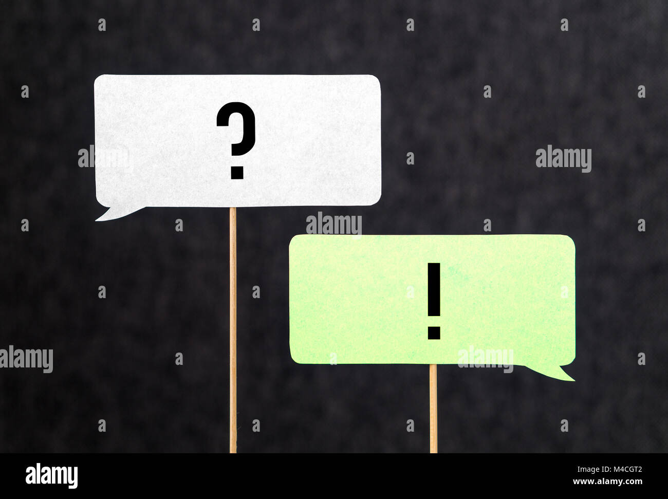 Question and answer. Interview, education and communication concept. Question and exclamation mark on cardboard - Stock Image