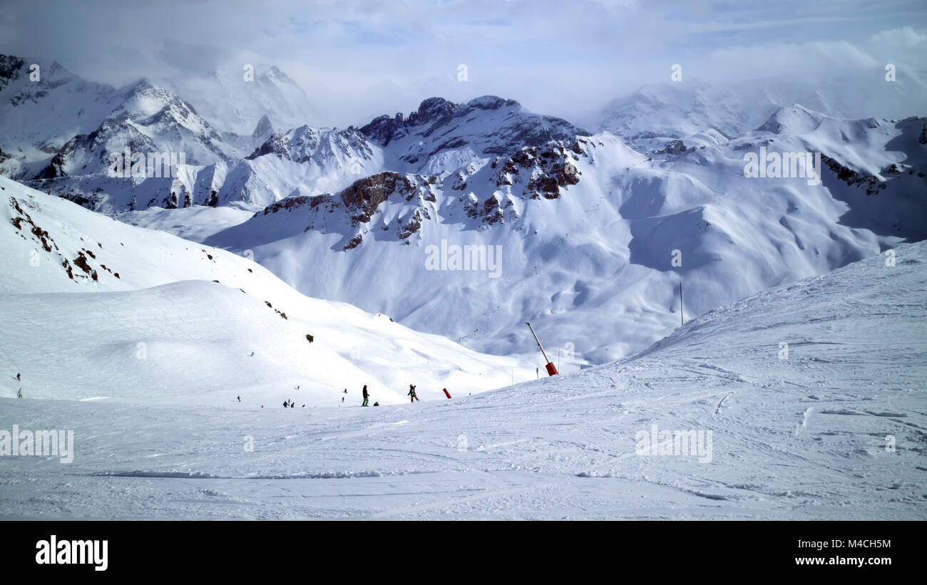 Panoramic Alps winter landscape of slopes, off piste skiing, snowboarding in French resort of Courchevel, Les Trois - Stock Image