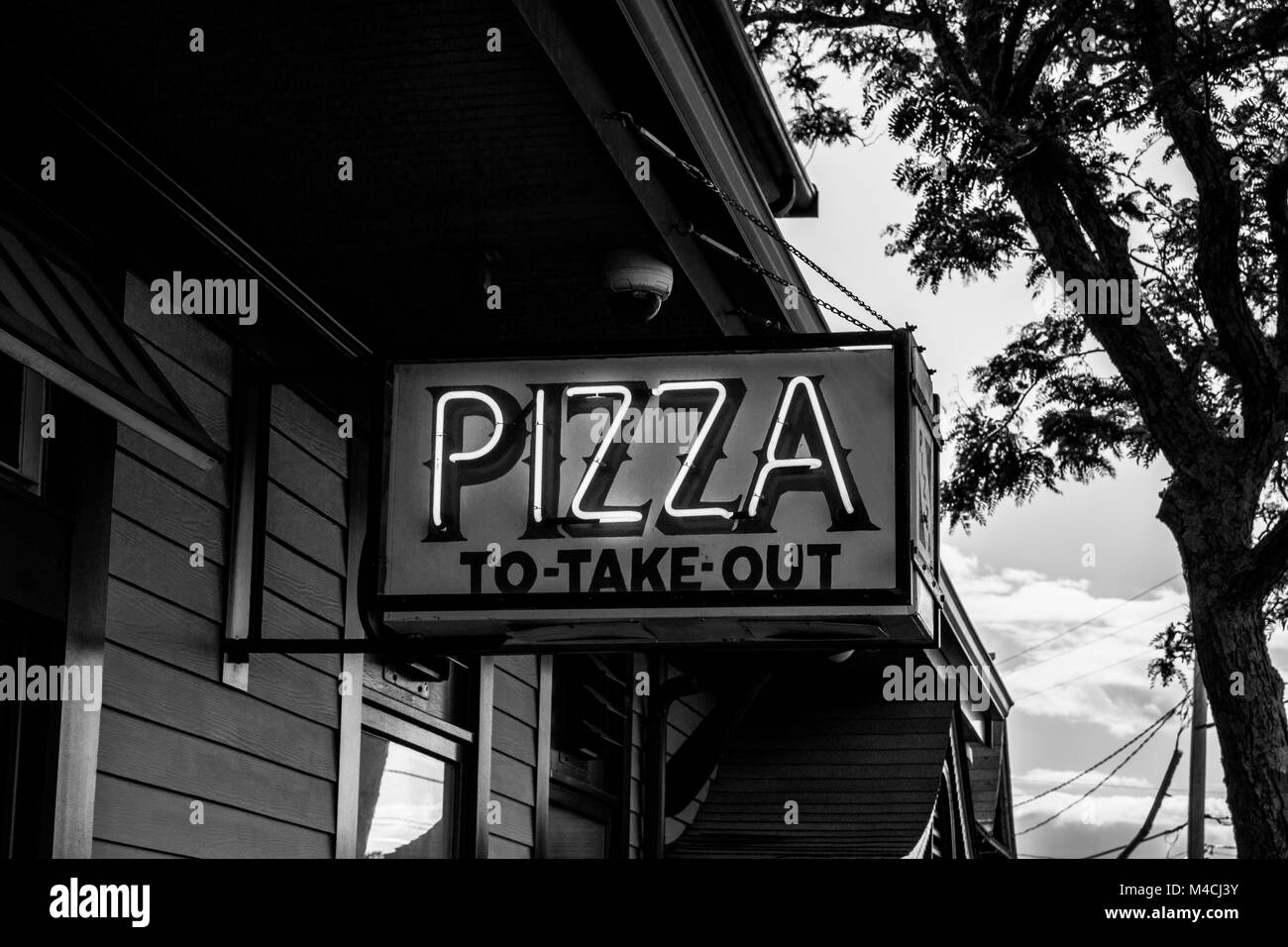 Pizza to take out. Black and white. - Stock Image