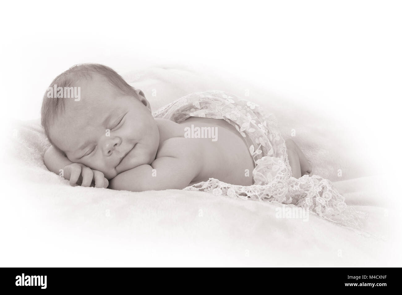 Newborn baby girl sleeping in nursery, beautiful new baby relaxed and sleeping - Stock Image