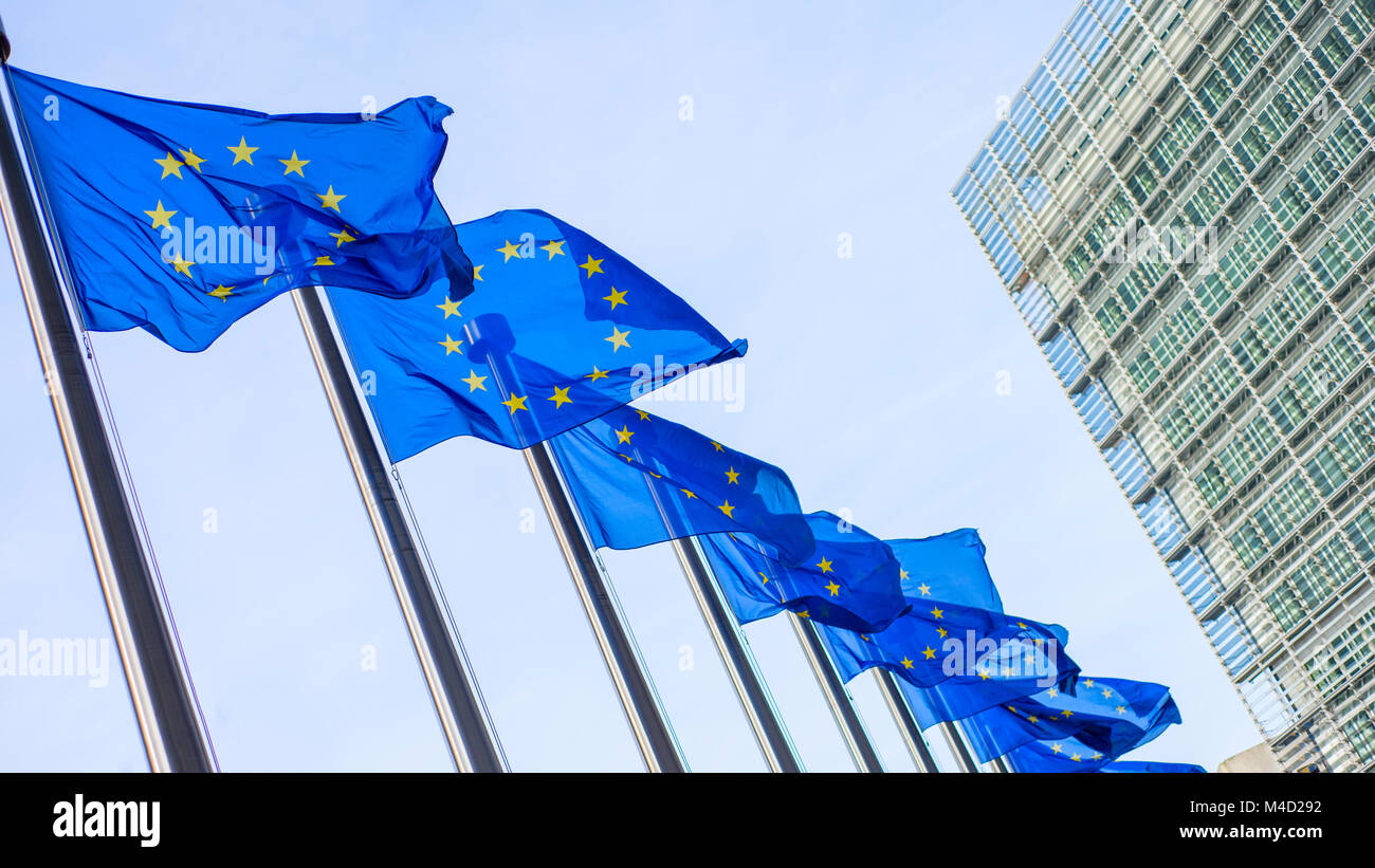 European Union flags in front of the Berlaymont building - Stock Image