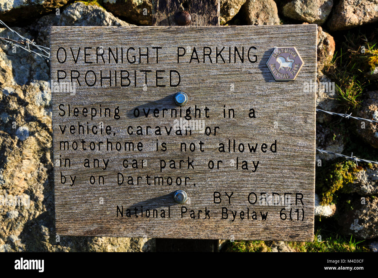 Wooden, Overnight parking prohibition sign on the Devonshire Dartmoor area. Stock Photo
