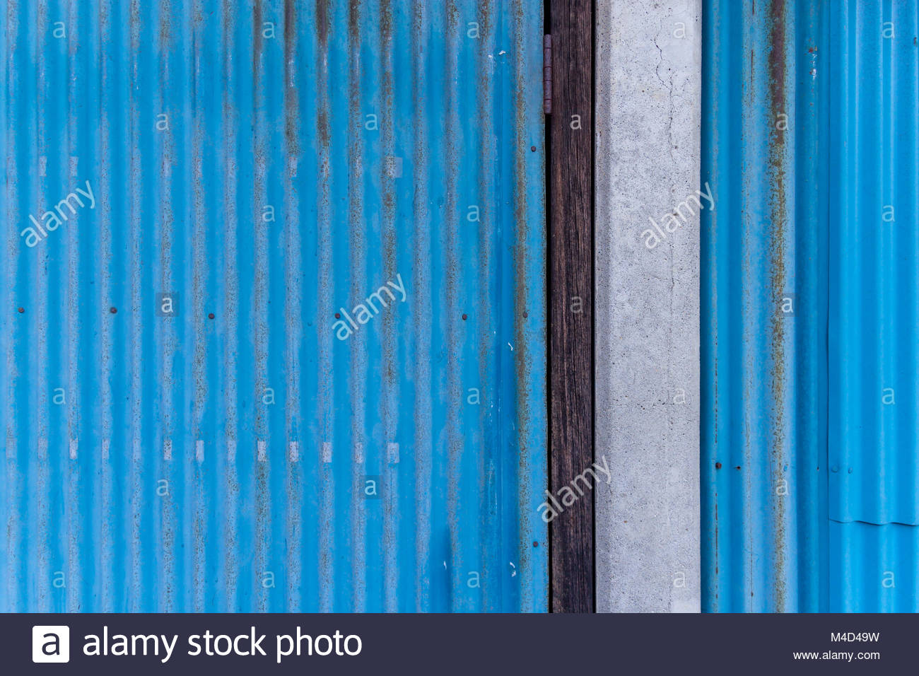 Blue corrugated metal, wood and concrete; Chiba, Japan - Stock Image