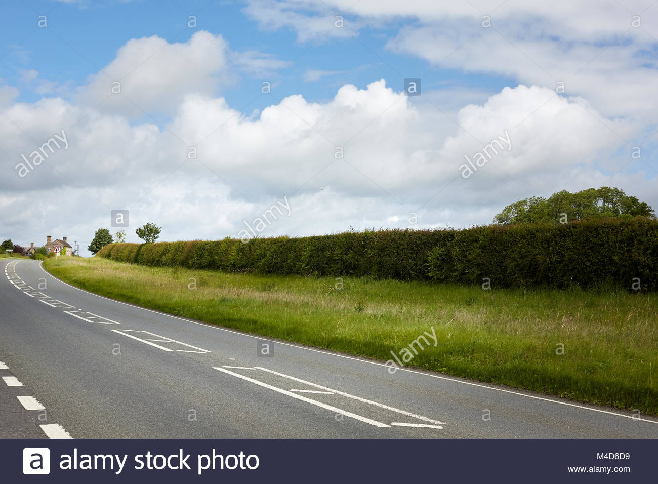 Beautiful overcast patches o f clouds, Soft and Bright day.  Open road with vanishing point and horizon line, highway, - Stock Image