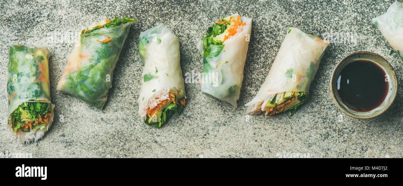 Vegan spring rice paper rolls with chopsticks, wide composition - Stock Image
